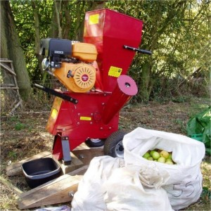 Petrol driven Shredder being used to pulp the Apples